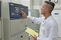 Q-Lab Florida's lab manager inspecting a QUV tester in preparation for a new customer test.